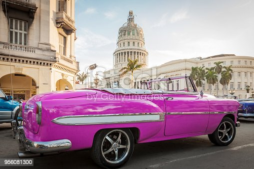 Pink convertible parked near Parque Central and the Capitol in Havana.
