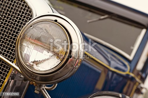Poetry in chrome, steel, and glass: close up view of a vintage automobile.