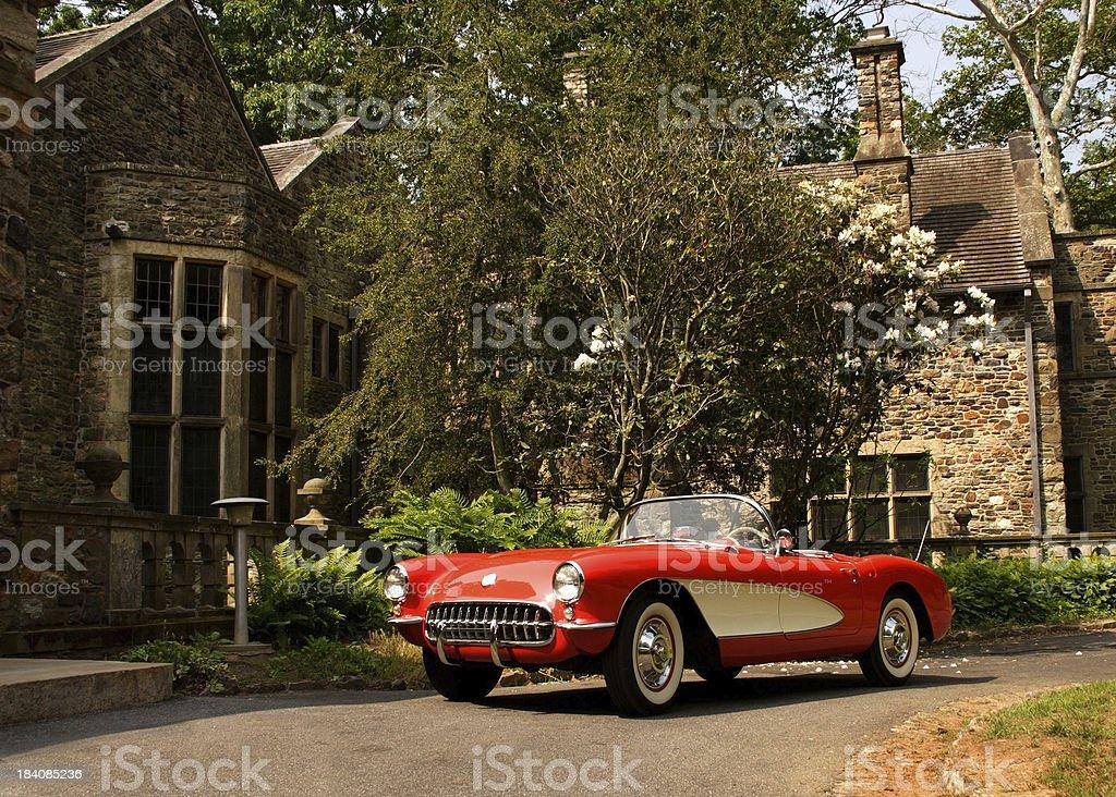 Classic Car & Stone House stock photo