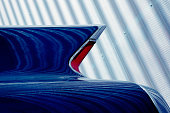 Classic Car Tail Fin Against Corrugated Iron Metal Wall