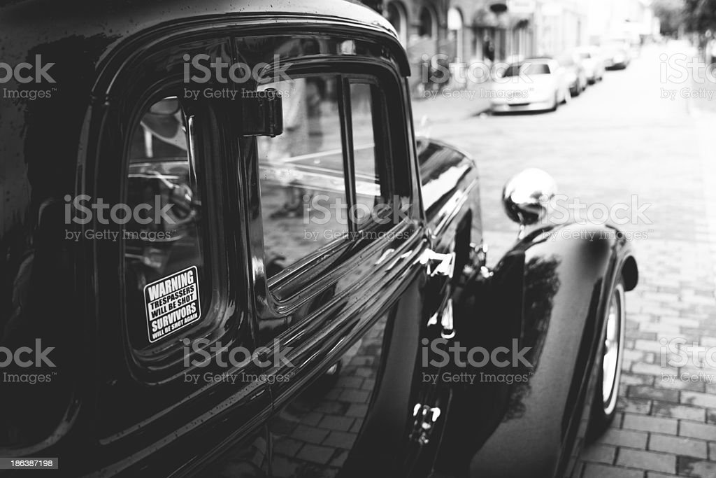 Classic car with a warning sticker against trespassers stock photo