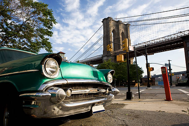Classic car with view of Brooklyn Bridge stock photo