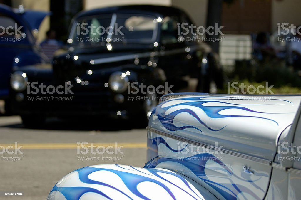 Classic cars facing each other royalty-free stock photo