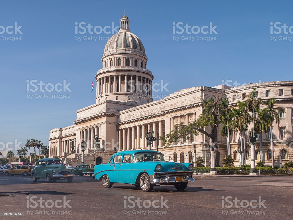 Classic cars in front of the Capitol in Havana. Cuba stock photo