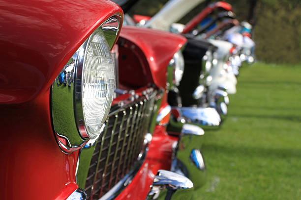 Classic Cars Row of classic 1955 - 1957 Chevys at a car show. car show stock pictures, royalty-free photos & images