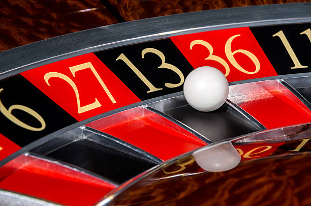 Classic casino roulette wheel with black sector thirteen 13 stock photo