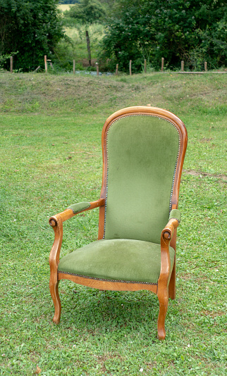 Vintage chair on green lawn on brocante sale