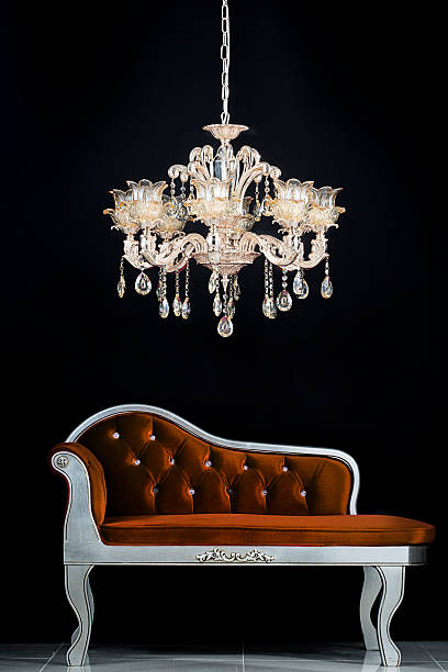 Classic chandelier Studio shot of classic chandelier on the black background. chandelier stock pictures, royalty-free photos & images