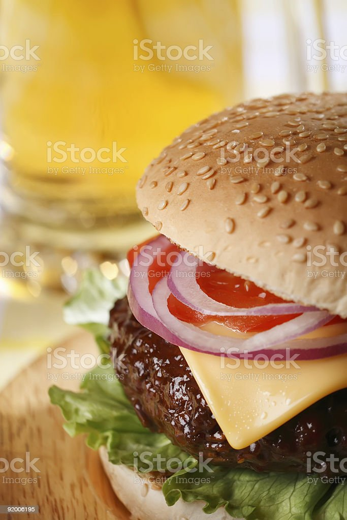 classic cheeseburger with beer on background royalty-free stock photo