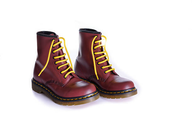 classic cherry red oxblood lace-up boots with yellow laces - postal worker stok fotoğraflar ve resimler