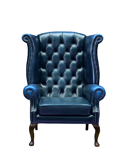 Classic Chesterfield luxury armchair Classic Chesterfield luxury blue armchair isolated on white armchair stock pictures, royalty-free photos & images