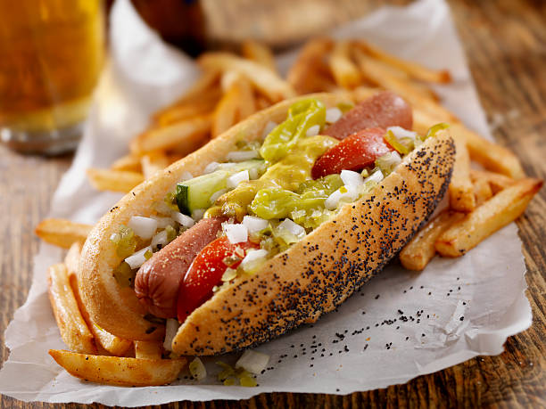 classic chicago dog with fries - hot dog stock pictures, royalty-free photos & images