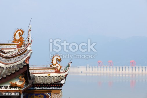 classic chinese housetop and three gorges dam