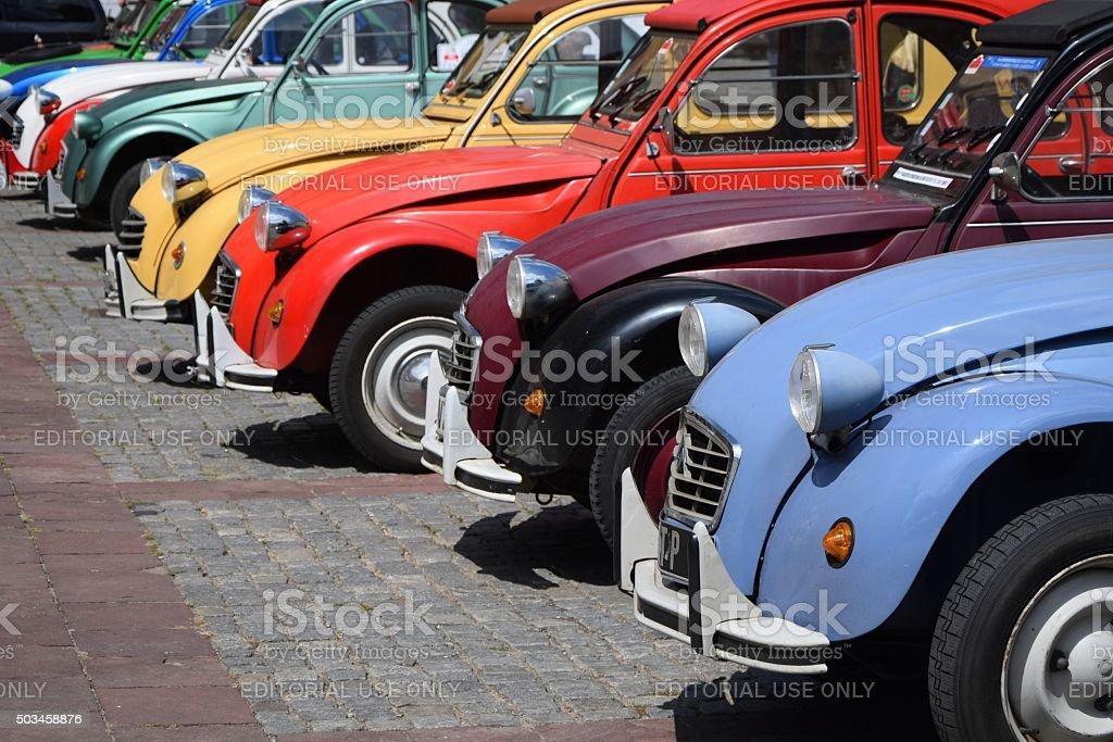 Classic Citroen 2CV cars in a row on the street stock photo