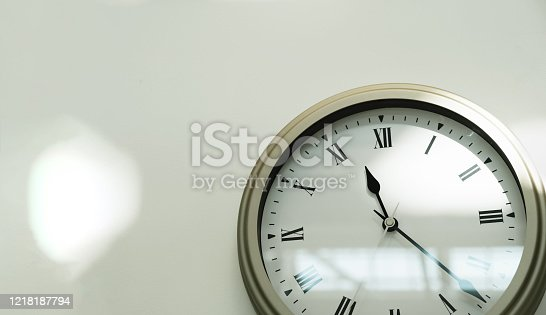 Watch on the white wall in the house. Close-up. Copyspace