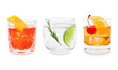 Classic cocktails - Negroni, Gin Tonic and Old-Fashioned isolated on white