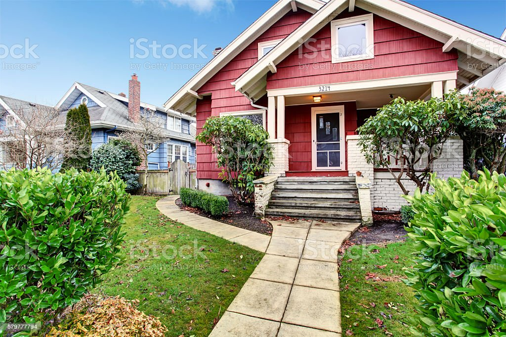 Classic craftsman old American house exterior in red and white. stock photo