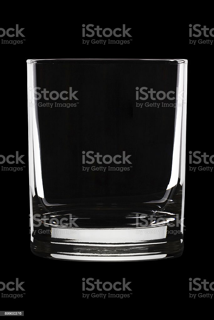 Classic crystal whiskey glass in black background stock photo