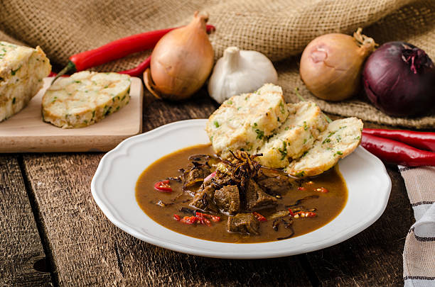 classic czech goulash with dumplings - tsjechië stockfoto's en -beelden