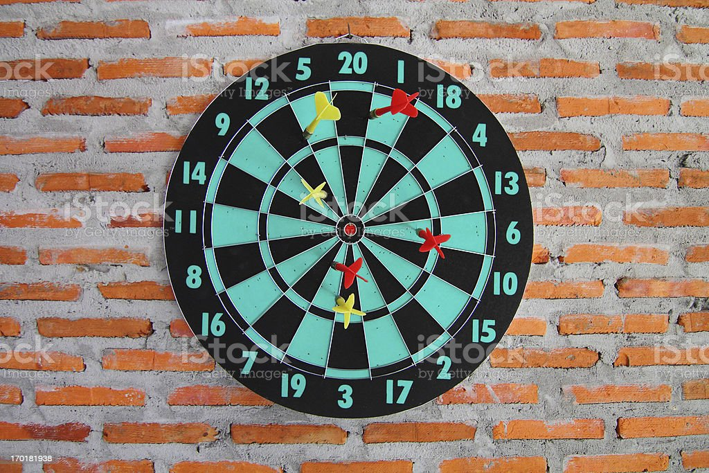 Classic darts board on brick wall texture background royalty-free stock photo