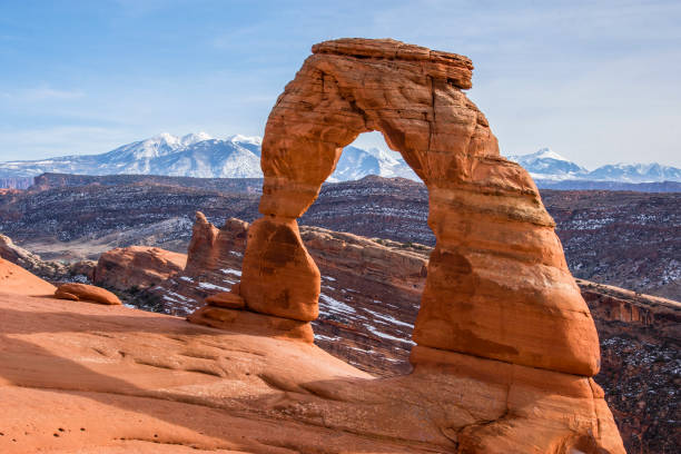 Classic Delicate Arch View of Delicate Arch with the La Sal Mountains in the background. Arches National Park. American Southwest. navajo sandstone formations stock pictures, royalty-free photos & images