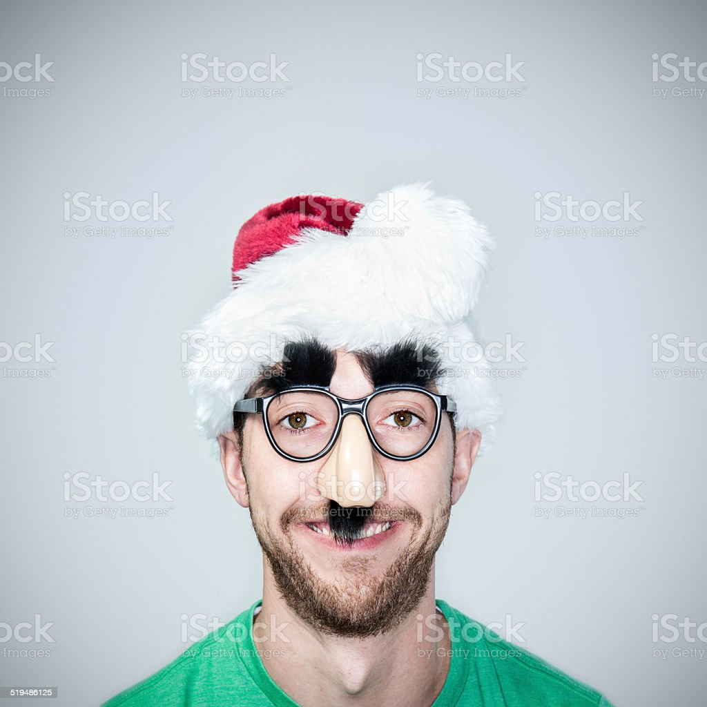 Classic Disguise Glasses on Christmas Man stock photo