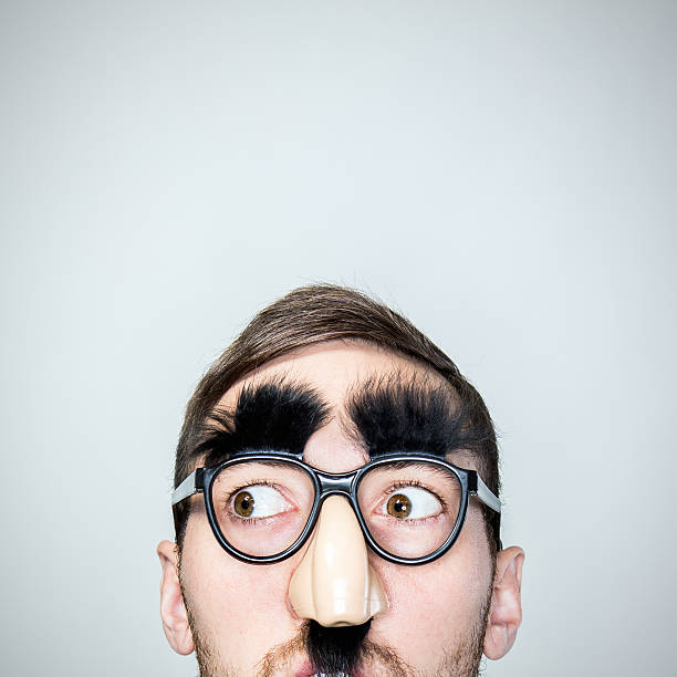 classic disguise glasses on man - mask disguise stock photos and pictures