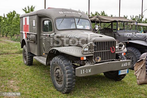 Classic Dodge WC-54 Ambulance used during the World War II exposed in meeting of military vehicles The Column of Liberation in Zello di Imola, BO, Italy - April 29, 2012