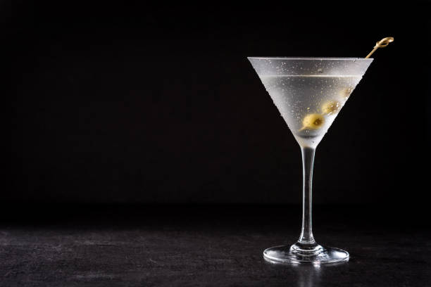 Classic Dry Martini with olives Classic Dry Martini with olives on black background martini stock pictures, royalty-free photos & images