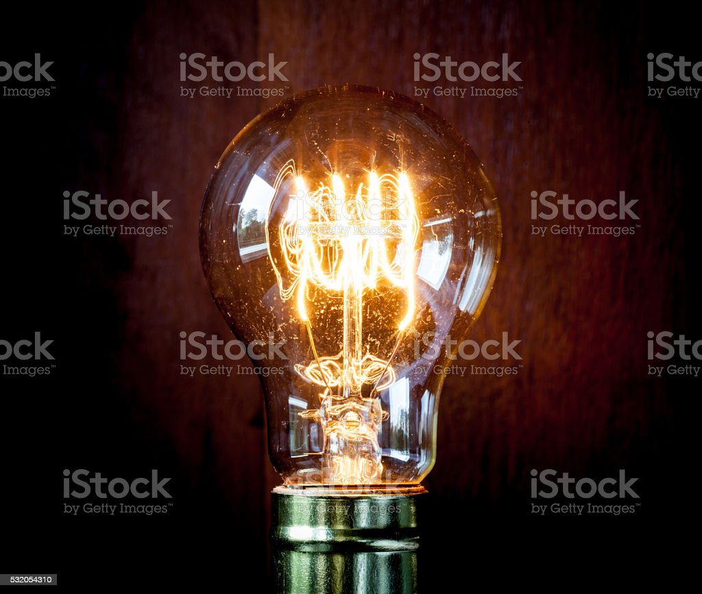 Classic Edison light bulb with looping carbon filament. stock photo
