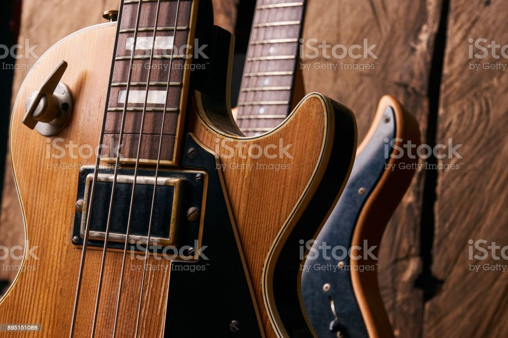 Classic electric guitar and wooden electric bass guitar stock photo