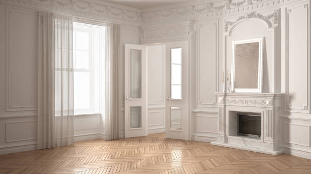 Classic empty room with big window, fireplace and herringbone wooden parquet floor, vintage white interior design stock photo