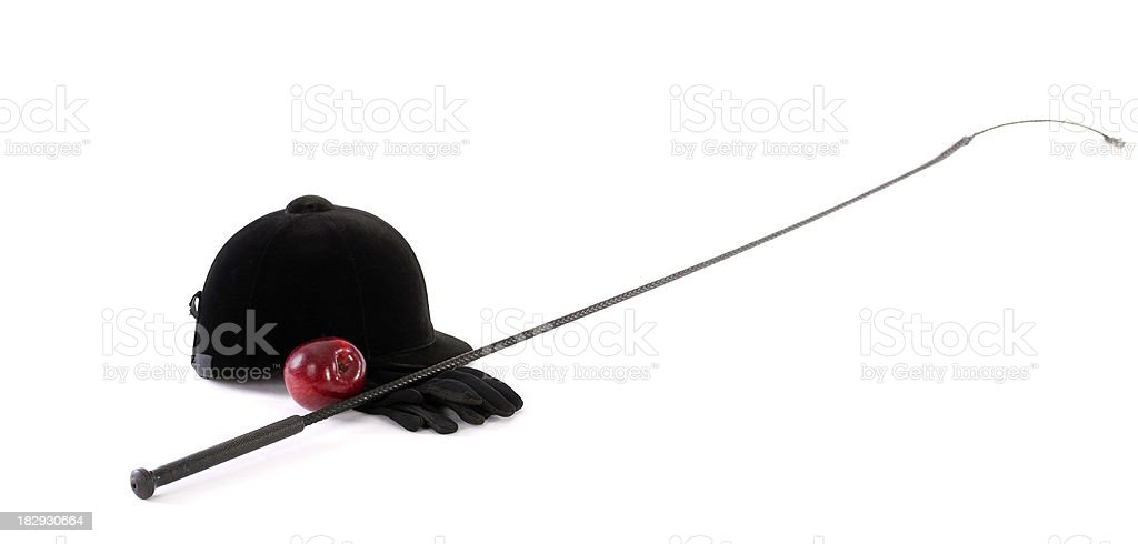 Classic Equestrian Helmet, Whip, Gloves And Apple stock photo