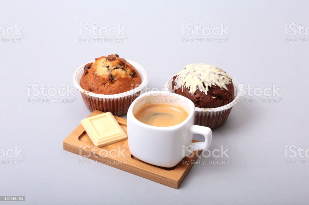 Classic espresso in white cup with homemade cake and chocolate on white background. stock photo