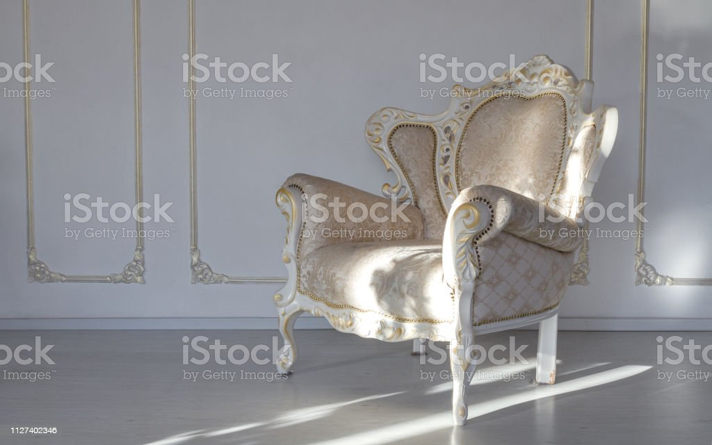 Classic textile white armchair in white room