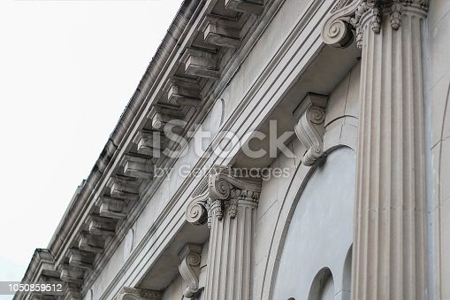istock Classic Facade Column Building Roof Angled View From The Street 1050859512