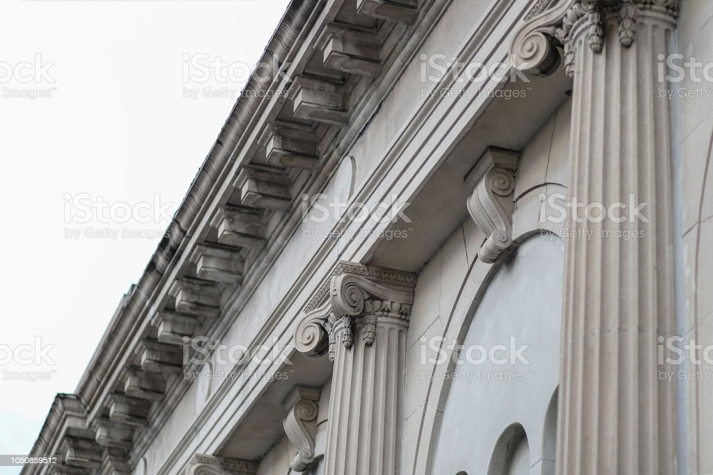 Classic Facade Column Building Roof Angled View From The Street stock photo