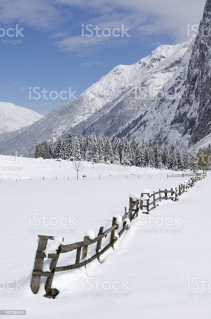 Classic fence in the snow royalty-free stock photo