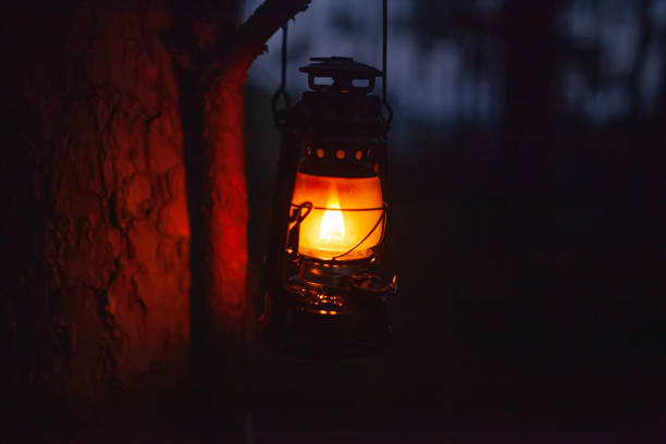 Classic fire lantern for light on night at forest stock photo