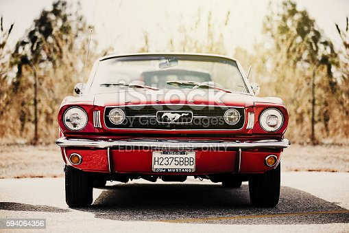 istock Classic Ford Mustang convertible parked outdoors. Vintage filter. 594064356