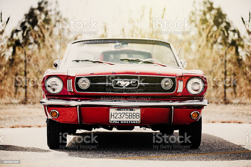 Classic Ford Mustang convertible parked outdoors. Vintage filter. stock photo