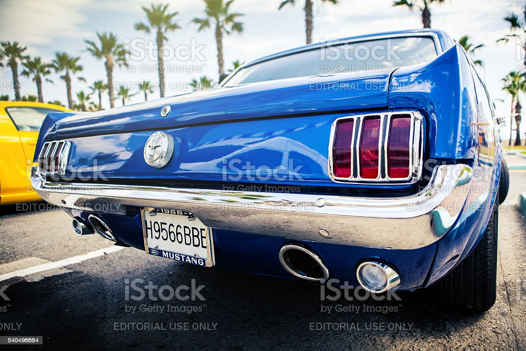 Classic Ford Mustang in blue color. Rear view. stock photo