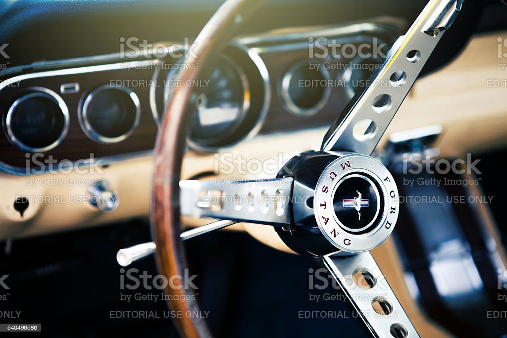 Classic Ford Mustang interior. Steering wheel detail. stock photo