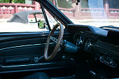 Subotica,Serbia -July 05,2015: Ford Mustang 289 edelbrock interior on Annual oldtimer car show Subotica 2015. Various vintage cars and motorcycles.In organization of Oldtimer Club Subotica. Selective focus on steering column and wheel.