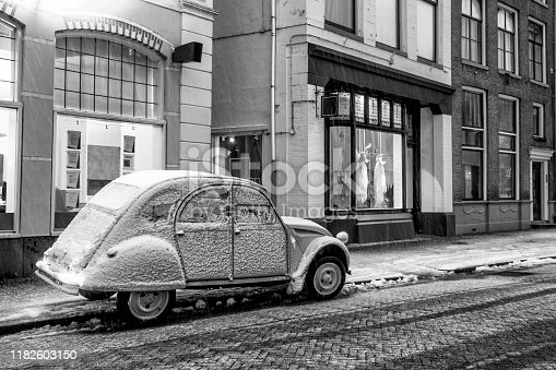 Classic French 2CV car parked on the side of the street during winter in the city of Zwolle, The Netherlands.