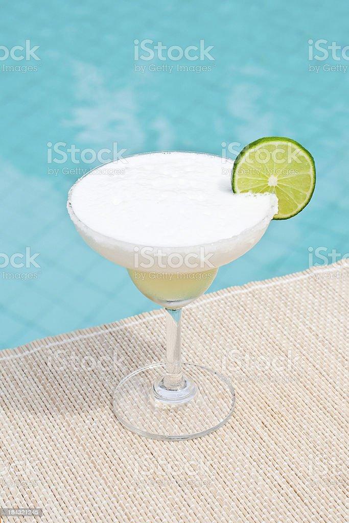 Classic Frozen Margarita cocktail near waterpool on the mat stock photo