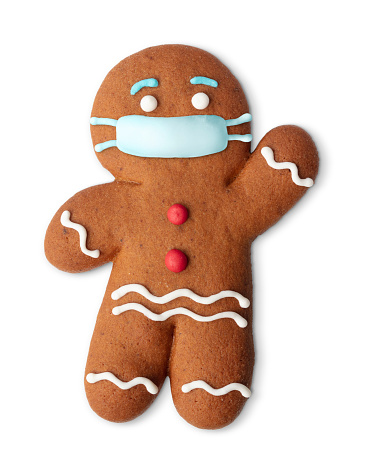 Classic gingerbread cookie man with medical mask isolated on white. Covid joke. Christmas objects. Coronavirus christmas decor.