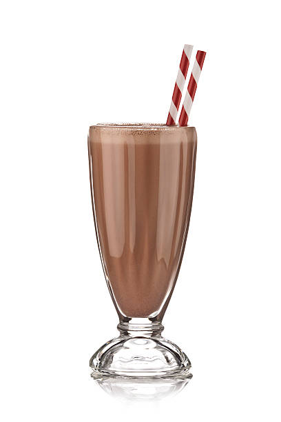 classic glass of chocolate milkshake on white backdrop. - milkshake stockfoto's en -beelden