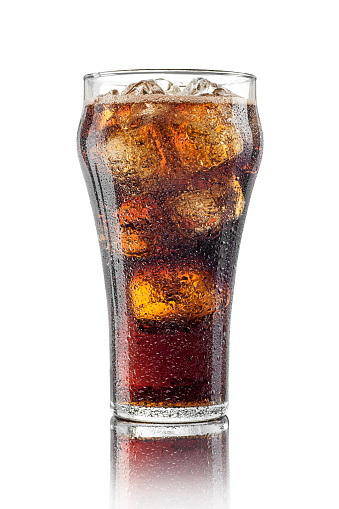 High resolution, digital studio shot of an ice-cold, freshly poured glass of cola in a classic cola glass with ice cubes. Sharply focused, aspirational style shot, showing condensation and a thin layer of foam, with a distinct surface reflection, isolated on a pure white background.