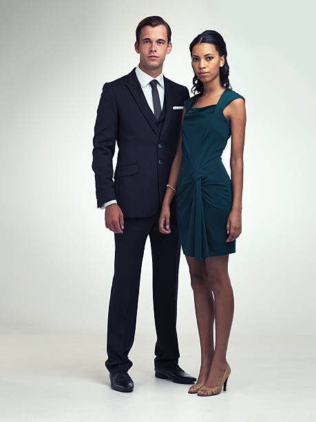 Classic good looks A full length portrait of an attractive young man and woman wearing vintage evening wear evening wear stock pictures, royalty-free photos & images